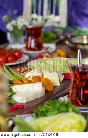 Delicious Traditional Turkish Breakfast On Wooden Table