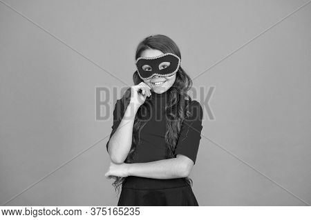 New Year Party. Carnival Party. Masquerade Concept. Kid Wear Eye Mask. Girl Wear Mask Orange Backgro