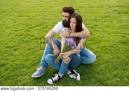 Enjoying Intimate Moments. Family Relax On Green Grass. Family Couple In Love. Family Vacation. Fami