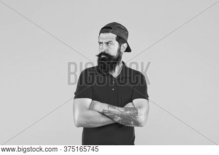 Cool And Free Man. Serious Man Yellow Background. Bearded Man Keep Hands Crossed With Confidence. Ca