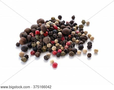 A Mixture Of Peppers. Black, White, Red Polka Dots. Isolated On A White Background. Selected Sharpne