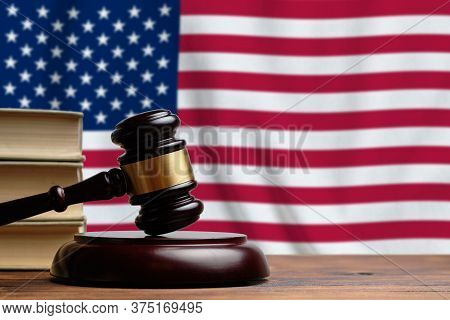 Justice And Court Concept In United States Of America. Judges Gavel On The Background Of The Usa Fla
