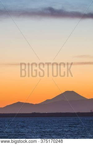 Mountain Fuji And Tokyo Bay At Sunset Time In Winter Season.tokyo Bay Is A Bay Located In The Southe
