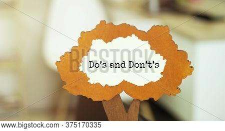 Figure Of A Tree With Text Dos And Donts Inside The Foliage. Business Concept