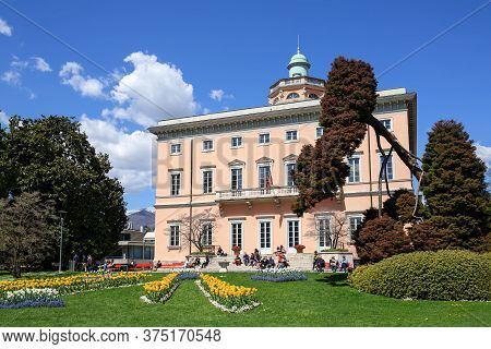 Lugano, Switzerland - April 17, 2018. Villa Ciani Of 19th Century In The Park Ciani At The Lake Luga