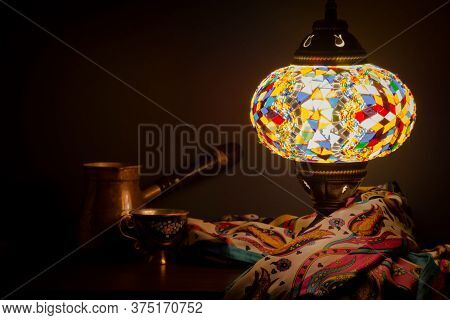 Turkish Cafe Illuminated By Turkish Lamp And Silk Scarf