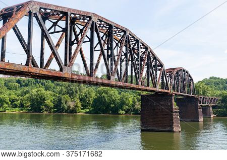An Old Steel Railroad Trestle Bridge Over The Monongahela River In Homestead, Pennsylvania, Usa On A
