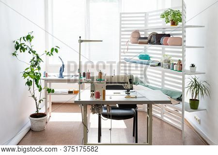 There Is Sewing Equipment In A Spacious Bright Room