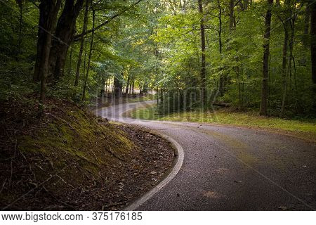 The Winding Road Or Paved Path That Encircles Grundy Lakes Park In Tracy City, Tennessee Of The Sout