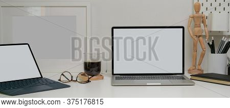 Modern Home Worktable With Mock-up Laptop, Tablet, Glasses, Supplies And Decorations