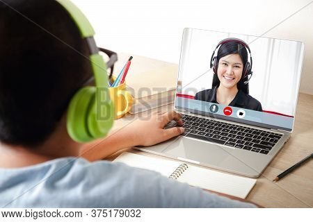 Asian Male Students Wear Headphones, Use A Notebook Computer, Learn Via Video Call. Online At Home.