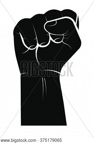Black Hand Clenched Into A Fist. Symbol Of Strength, The Protest Movement, The Struggle For Rights A