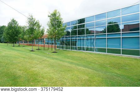 Modern Company Building Exterior With Blue Glass