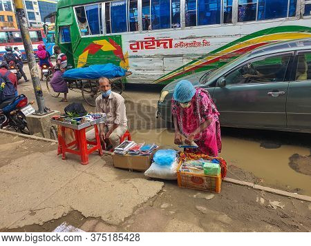 Dhaka,bangladesh-07/07/2020:poor People In Bangladesh Are Trying To Sell Goods On The Street With Mi