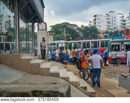 Dhaka,bangladesh-07/07/2020: People Gathered In The Bus Stand Waiting For The Bus With Masks On Duri