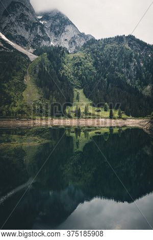 Lake Gosausee With Reflection In The Austrian Alps