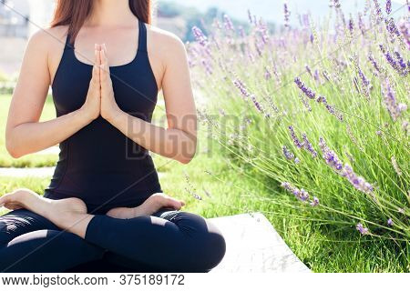 Yoga Meditation In Home Garden. Woman Doing Morning Exercise In Lavender. Peaceful Moments In Nature