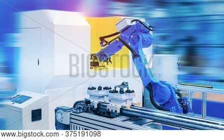 robot gripping and smart robot working on smart factory,industry 4.0 and technology.