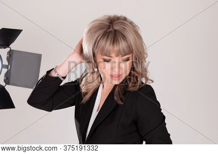 Portrait Of Beautiful Business Woman In Photo Studio