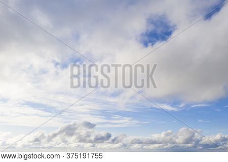 Aerial View White Clouds In Blue Sky. View From Drone. Aerial Top View Cloudscape. Texture Of Clouds