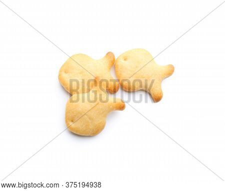 Delicious Crispy Goldfish Crackers On White Background, Top View