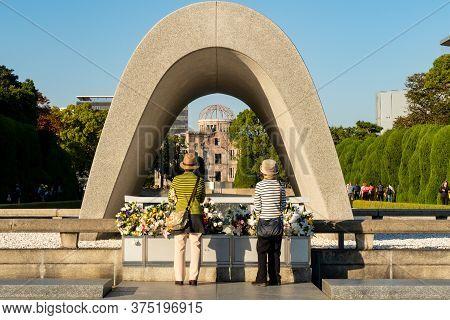 Hiroshima, Japan. Hiroshima Peace Memorial Park. 31/10/2019. Two Female Japanese Tourists Contemplat