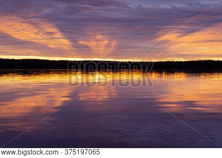 Water Surface. Sunset Sky Background. Gold Sunset Sky With Evening Sky Clouds Over The Lake. Small W