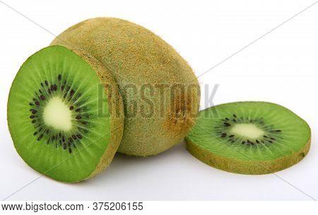 Close Up Of Kiwi Cut In Half, Concept Of Healthy Fruit Kiwi, One Sliced kiwi On White Background
