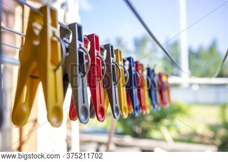Colorful Clothespin On The Hangers. Plastic Clothespins In Different Colors.