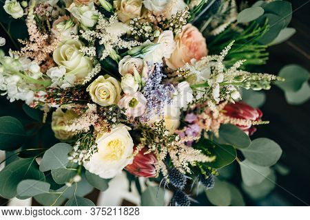 Bridal Bouquet Of White And Cream Roses, Branches Of Eucalyptus Tree, Protea, Eryngium And Delphiniu