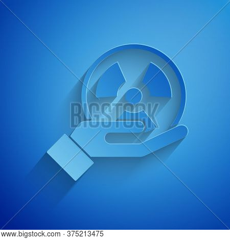 Paper Cut Radioactive In Hand Icon Isolated On Blue Background. Radioactive Toxic Symbol. Radiation