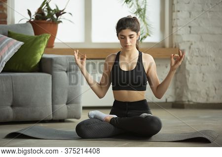 Enjoyment. Sporty Arabian, Muslim Beautiful Young Woman Taking Professional Yoga Lessons Online And