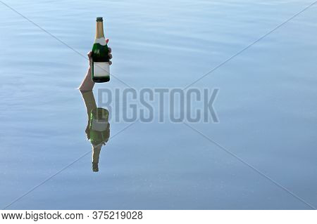 Young Woman Hand Up A Bottle Of Champagne