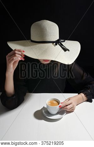 Young Woman With Cup Of Coffee And Red Nail Polish
