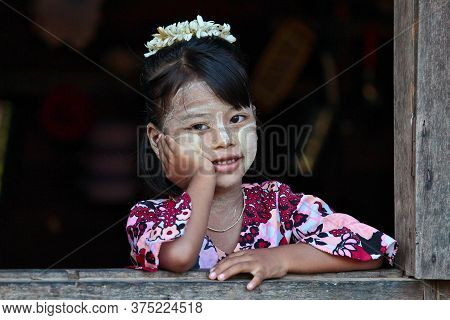 Bagan, Myanmar - Nov 14, 2019: Burmese Girl Looking Out Of Window In Bagan, Myanmar Former Burma In