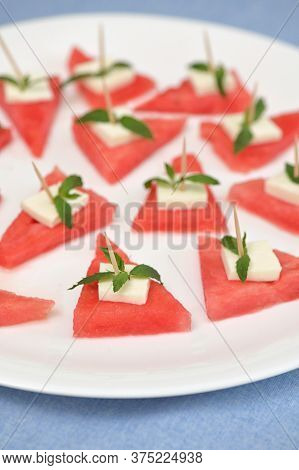 Closeup Slices Of Red Watermelon And Cheese