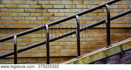 Exterior Cement Profile Of Stairs And Railings On Brick Wall Background.