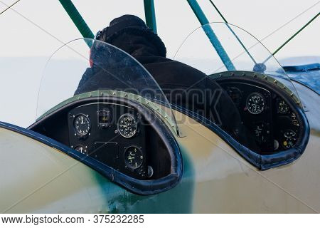 Cabin And Dashboard Of A Retro Aircraft, Biplane Cabin Rear View, One Pilot Sitting At The Controls,