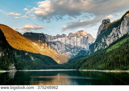 Sunny Sunset Colorful Summer Alpine View. Peaceful Mountain Lake With Clear Transparent Water And Re