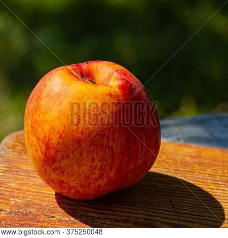 Fruit Of A Red Ripe Peach Lies On A Wooden Board. Cooking Food.