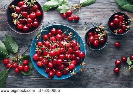 Cherry bowl full of fresh cherries,  seen from above.