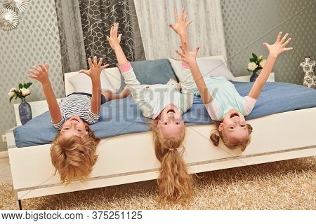 Happy children play together at a bedroom at home. Family concept.