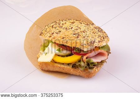 Ciabatta With Vegetables, Egg, Ham, Cheese On A White Background