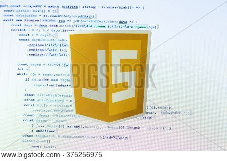 Moscow, Russia - 1 June 2020: Javascript Js Logo Sign With Program Code On Background Illustrative E