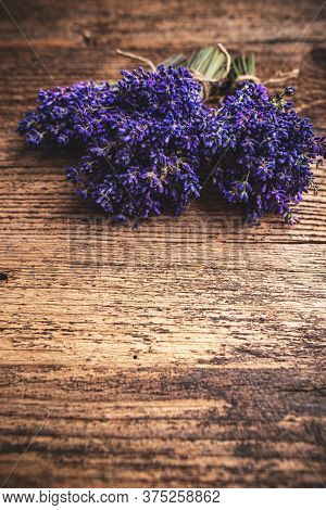 Bouquets Of Fresh Lavender On A Rustic Wooden Background