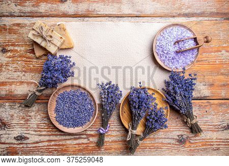 Plates With Dried Lavender, Bathroom Salt, Soap And Bunch Of Lavender Flowers, Copy Space