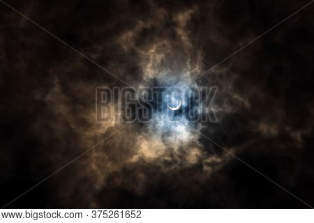 Surreal Dramatic Solar Eclipse Covered By Clouds. Natural Phenomenon.