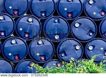 Closeup Stack Of Chemical Barrels. Blue Oil Drum. Plastic Oil Tank. Toxic Waste Warehouse. Hazard Ch
