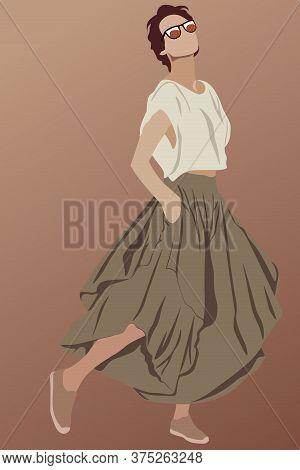 Short Haired Glamorous Brunette Dressed In Brown Long Skirt, Shoes, Sunglasses And White T-shirt. Sh