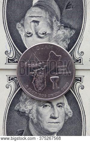 A Quarter Of Guam On Us Dollar Bills. Symmetric Composition Of Us Dollar Bills And A Quarter Of Guam